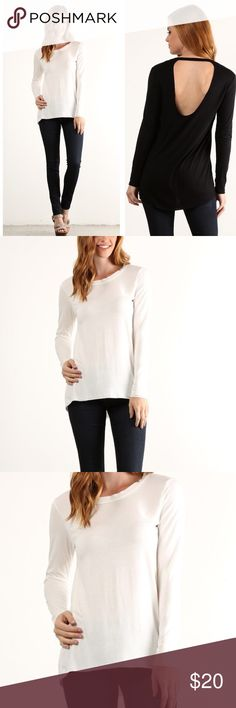 CREAM LONG SLEEVES TEE Waist length long sleeve top. Relaxed style with a crew neck and open back. Model is wearing a small. Also available in black. Made in the USA. NO MODELING. NO TRADES. Tops Tunics