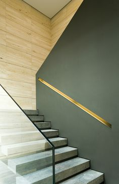 Contemporary staircase using both glass handrail and half wall with cap...