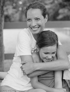Christy Turlington, looking as fab as always, throws her arms around daughter Grace