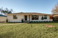 """Updated, painted ranch exterior with modern and contemporary details like a cedar slat wall, horizontal fence, and modern windows.  """"After"""" photos of 10th flip - It's Great to Be Home"""