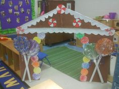 """The gingerbread house made for dramatic play area... could paint a sheet and hang it over the clothing rack to make a """"house"""""""