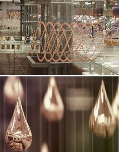 Golden Raindrops Rise and Fall in Singapore Airport Installation