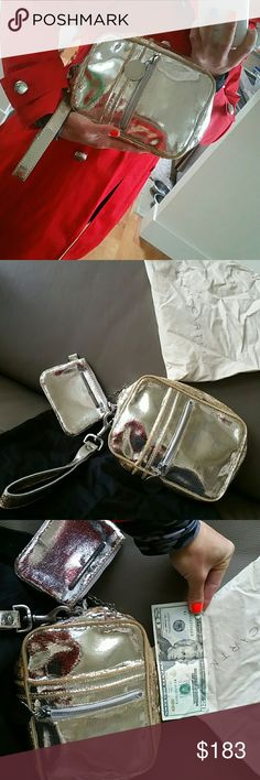 STELLA MCCARTNEY SILVER WRISTLET/CLUTCH&CoinPurse Absolutely stunning!!!  Holiday must have bag!!  VERY versatile size and many pockets PLUS a mini detachable coin purse on a chain.  Gorgeous detachable handle on the wristlet bag to easily convert it to a clutch.  ZERO TEARS ZERO ODORS ZERO STAINS IN LINING.  ** Used a couple of times and I needed something to match my gold dominant closet** Stella McCartney Bags Clutches & Wristlets