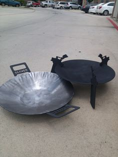 "www.hellspits.com 24"" disc cooker / fire pit with removable wok. This one have clients last name in handles ."