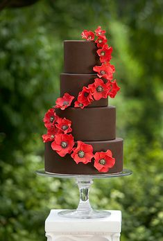 A Four-Tier, Brown Fondant Wedding Cake - with Cascading Red Flowers by AP Signature Cakes |