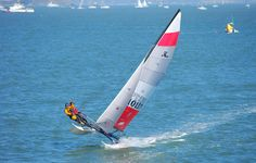 Friendly wave from the crew of a Hobie 16 in San Francisco Bay