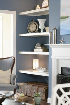 Blue and white living room shelves alcove shelving, painted shelving, shelv Coastal Living Rooms, Living Room Grey, Home Living Room, Blue And White Living Room, Blue Grey Walls, Apartment Decoration, Muebles Shabby Chic, Living Room Shelves, Alcove Ideas Living Room