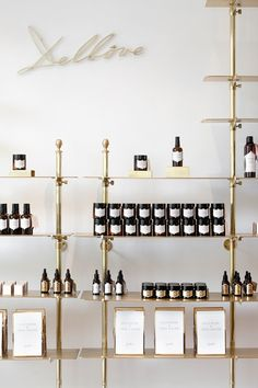 Brass shelving in the Delbôve boutique in Brussels. Design by Christophe Remy.