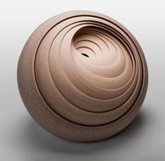 British artist Matthew Chambers produces beautifully intricate concentrical ceramic objects.