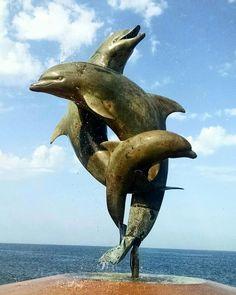 Dolphin sculpture on the Malecon in Puerto Vallarta, Jalisco Mexico