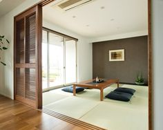 Japanese-style living room, with tatami mats and minimal furniture, make for a serene and multi-purpose room Minimal Furniture, Relaxation Room, Tatami Room, Home, Apartment Interior, Living Room Japanese Style, House Interior, Home Design Plans, Interior Deco