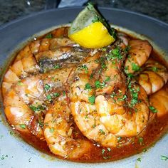 In New Orleans, Barbecue Shrimp are sautéed jumbo peel and eat shrimp in a tangy Worcestershire butter sauce. They are tender and succulent and the flavorful broth will make you want to lick the bowl clean! Creole Recipes, Cajun Recipes, Shrimp Recipes, Fish Recipes, Cooking Recipes, Healthy Recipes, Recipe For Jumbo Shrimp, Haitian Recipes, Shrimp Appetizers