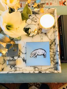 A decorative glass tray featuring a hand-painted hippo illustration, finished with an 18kt gold edge detail. London-based artist, Melissa LaFave uses the traditional decoupage method to merge contemporary design with a classic artistic technique. Looks great on a coffee table, dressing table, desk or wall.