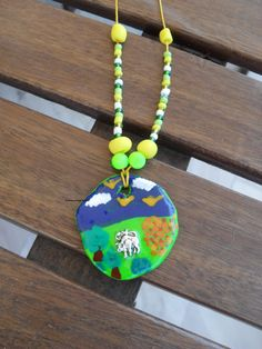 neckless with handpainted,polymer clay piece and horoscope