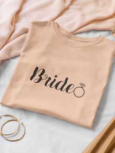 """A simple but stylish """"Bride"""" printed bride shirt for the classic bride. Because when you go back and forth to prepare everything to run smoothly before the wedding you need a comfy shirt to get things done. Bachelorette Party Gifts, Bride Shirts, Elegant Bride, Future Wife, Gifts For Wife, Special Day, Going Out, Tee Shirts, Comfy"""