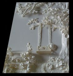 3d relief sculpture of a cottage rose garden and tree swing