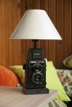 Table lamp in the Loft style. Made on the basis of the old photo camera Amateur. Made by StrangeLamps.