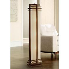 A warm walnut wood finish and creamy linen shade merge in this impressive column floor lamp inspired by Art Deco style lighting.