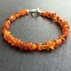 Our 2 year old wore a amber necklace for a long time to help with teething.  THis stunning necklace reminds me of her nekclace!! Find more handmade #jewelry over at @yvonneantoinettejewellery #amber #necklace #handmade #etsy #featurefriday #handmadeology