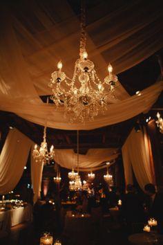 Sheer drapes and chandelier candlelight decor from a wedding we did. So beautiful. #wedding #lighting www.nashvilleeventlighting.com (Photo Credit: Kristyn Hogan)