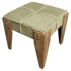 Sage tufted ottoman with distressed wood legs.   Product: OttomanConstruction Material: Wood and fabricCol...