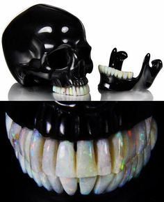 Black Obsidian skull. The skull is 5.3 inches long from front to back, it has a moveable jaw, and all the teeth are made of Australia opal. ...