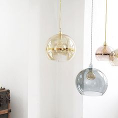The Rowan Pendant Gold Stripe Golden Smoke glass pendant light features a simple yet sophisticated spherical glass shade, twisted gold cord and neat metal ceiling rose. Metal Ceiling, Ceiling Rose, Ceiling Pendant, Pendant Lamp, Glass Ceiling, Pendant Lights, Glass Pendant Light, Glass Pendants, Gold Pendant