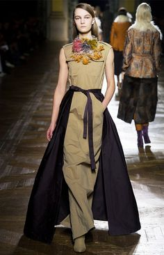 A front-tie skirt is layered over a full length Dries Van Noten dress.