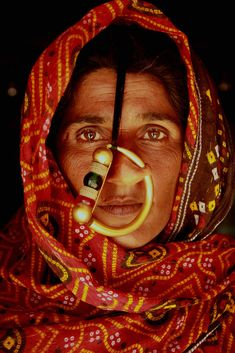 Dhaneta Jat woman wearing an over-sized nose ring . Kutch, Gujarat, India.