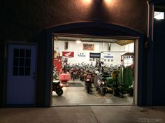 Night time picture into the Rizingson Vintage Motorcycle workshop.