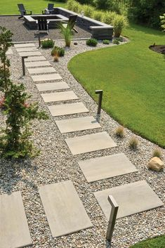 Outdoor walkways are the red carpet of your landscape. They lead you and your guests to destinations unknown safely and with style! In this article, we've compiled a list of 9 gorgeous walkway designs that will elevate your home's exterior! Landscape Stepping Stones, Stepping Stone Walkways, Patio Stone, Wood Walkway, Outdoor Walkway, Backyard Patio, Rustic Outdoor Spaces, Outdoor Decor, Traditional Landscape