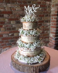 Statement nearly naked/ semi naked wedding cake finished with gorgeous silk gypsophila