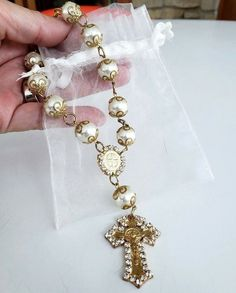 As found in original pouch for doll or statue, necklace caged filigree gold tone faux pearl beads with Saint Benedict marker and crucifix cross withclear rhinestone and lobster clasp. St Benedict Cross, Religious Jewelry, Stainless Steel Jewelry, Statue, Pearl Beads, Cross Pendant, Pendants, Pearls, Gold