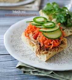 hat makes this Bánh Mì {Vietnamese-style Sandwich} just so special? Its fusion of flavors, the influence of French and Vietnamese, and the gorgeous toppings that transform it from plain Jane bread and pork to something spectacular, all made with the ease of the slow cooker.