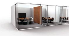 This workspace design is going all in with the glass office look.