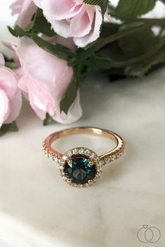 A ring as beautiful and unique as your love. Propose with a rose gold and blue spinel engagement ring, surrounded by a diamond halo. Robbins Brothers Sku: 0421688