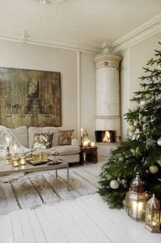 Love the crown molding, picture and lanterns by the simply decorated tree
