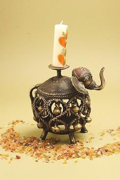 Candle Holder in Elephant Theme Material- Brass Technique- Handmade Weight- 400 gm M.O.Q- 50 pieces. Feel Free to get in touch in case of any query.