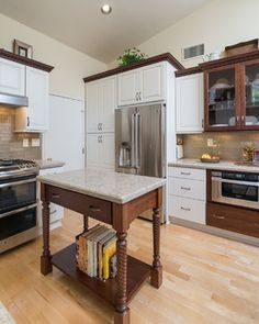 This #kitchenisland is a great way to make the most of the space in this #craftsman kitchen. Consider using one in your home! www.remodelworks.com