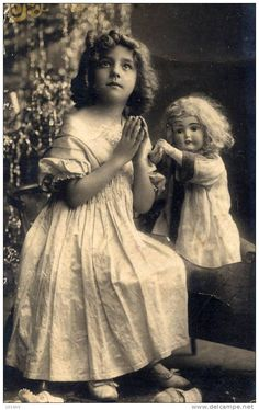 Beautiful old photo of a girl and her doll.