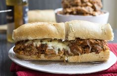 This slow cooker recipe for Italian Pulled Pork can be served in a sandwich smothered in Mozzarella or with pasta - either way it's one fantastic dish!