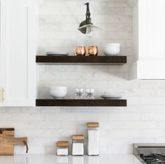 Modern Farmhouse White Cabinets, White Marble Backsplash, Open Shelving,  Brass Hardware, And Swing Arm Sconce With Kitchen Shelf Styling.