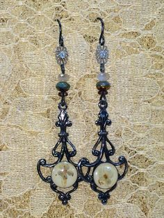 Victorian antiqued silver press flower green yellow earwires handmade wire wrap vintage assembled dangle pierced earrings Measures 2 1/2. long. This is a unique handmade assembled piece using new, vintage and antique treasures from garage sales, estate sales, artists, and sometimes good old junk! No two pieces are alike and a piece is never reproduced! You can be sure you are wearing or giving something made with love and guaranteed for life. On some pieces I can make minor adjustments like…