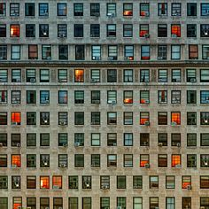 A wall of windows in NYC.  What do all those people do??