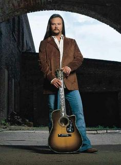 Travis Tritt and his guitar.