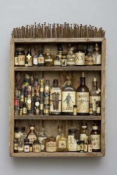 Medicine Cabinet: altered bottles for the dark and creepy overachievers among us. A lot of work but this would so make the Halloween decor! Deco Harry Potter, Cabinet Of Curiosities, Natural Curiosities, Potion Bottle, Witch Aesthetic, Altered Bottles, Assemblage Art, Halloween Crafts, Halloween Kitchen