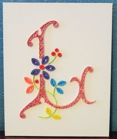 """Letter """"L"""" quilling on canvas"""