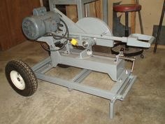 Chop Saw by thegallery -- Homemade heavy-duty chop saw mounted on a wheeled frame and featuring a retractable handle. http://www.homemadetools.net/homemade-chop-saw