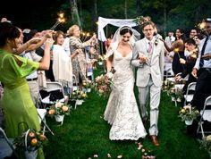68-bride-groom-walking-aisle-grass-vintage-outdoor