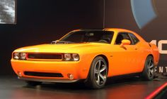 """When the third-generation Challenger was introduced in 2008, it was a perfect marriage between the glory days of muscle cars and today's modern safety and technology. Now Dodge is taking another page from the history books and adding its iconic """"shaker"""" hood to the classic-looking Challenger. Just as original Challengers are sought after now, this special Challenger is bound to be a popular choice among collectors in 2039."""